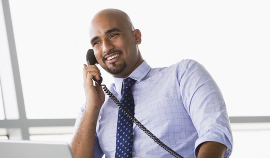 business guy smiling with phone